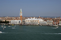 The skyline of Venice, St Marks square, Campanile, Palazzo Ducale and various craft on the canal. May 2007.