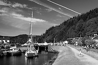 A yacht passing through the locks at Cairnbaan on the Crinan Canal, Argyll & Bute, Scotland