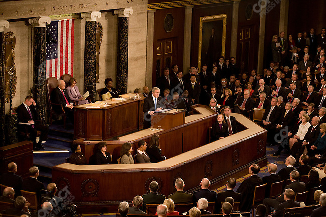 US President George W. Bush delivers his last State of the Union address to Congress, gathered at the Capitol Building. Sitting behind him are Vice President Dick Cheney, President of the Senate, and Representative Nancy Pelosi (D-CA), Speaker of the House of Representatives. Washington, D.C. January 28, 2008.