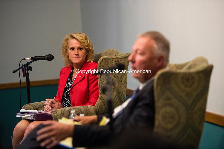 NAUGATUCK, CT- 20 October 2015-102015EC01-  Republican Tamath Rossi and democrat Warren Hess debate Tuesday night at the Howard Whittemore Memorial Library in Naugatuck. Erin Covey Republican-American