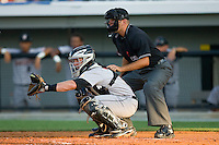 Catcher Chris Wallace #19 of the Greeneville Astros sets a target as home plate umpire Pat Hoberg looks on during an Appalachian League game against the Burlington Royals at Burlington Athletic Stadium June22, 2010, in Burlington, North Carolina.  Photo by Brian Westerholt / Four Seam Images