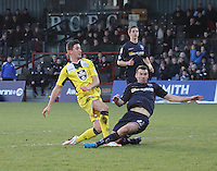 Paul Quinn tackles Kenny McLean late in the Ross County v St Mirren Scottish Professional Football League match played at the Global Energy Stadium, Dingwall on 17.1.15.