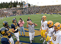 California captains' Chris Guarnero, Kevin Riley, Cameron Jordan and Mike Mohamed and ASU captains watch referee Larry Farina tosses a coin before the game at Memorial Stadium in Berkeley, California on October 23rd, 2010.  California defeated Arizona State, 50-17.