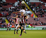 Mark Duffy of Sheffield Utd in action with Kory Roberts of Walsall during the Carabao Cup round One match at Bramall Lane Stadium, Sheffield. Picture date 9th August 2017. Picture credit should read: Jamie Tyerman/Sportimage