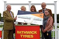 Connections of Caiya receive their cheque after winning The Byerley Stud EBF Fillies' Novice Stakes    during Bathwick Tyres Reduced Admission Race Day at Salisbury Racecourse on 9th October 2017