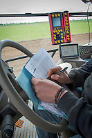 Drill operator filling in field paperwork