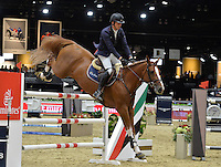 Harrie Smolders (Netherlands), riding Emerald at the Gucci Gold Cup International Jumping competition at the 2015 Longines Masters Los Angeles at the L.A. Convention Centre.<br /> October 3, 2015  Los Angeles, CA<br /> Picture: Paul Smith / Featureflash