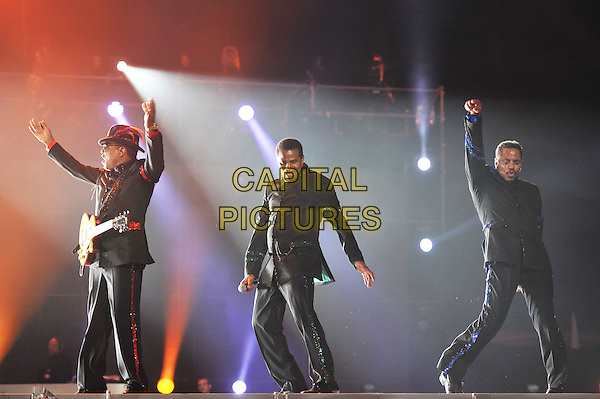 Tito, Jackie and Jackie Jackson .Michael Forever Tribute Concert at The Millenium Stadium, Cardiff, Wales, UK 8th October 2011.performing live in on stage .CAP/MAR.© Martin Harris/Capital Pictures.