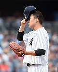 Masahiro Tanaka (Yankees), JULY 23, 2015 - MLB : New York Yankees starting pitcher Masahiro Tanaka tips his hat down during a baseball game against the Baltimore Orioles at Yankee Stadium in New York, United States. (Photo by AFLO)