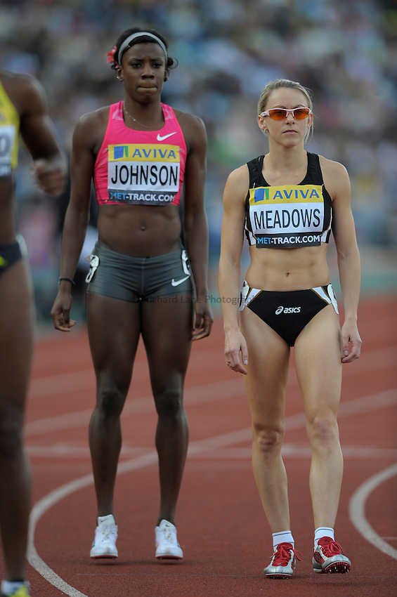 Photo: Ady Kerry/Richard Lane Photography..Aviva London Grand Prix. 24/07/2009. .Jenny meadows (R) is loomed over by Alysia Johnson at the start of the 800m