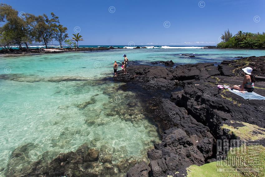 A family enjoys the tide pools at Richardson Beach Park, Hilo, Big Island.