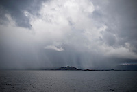 Snow storm over small island on Norwegain coast