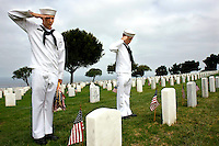 Saturday, May 22, 2009.  Fort Rosecrans National Cemetery, San Diego California, USA:  Cadets George Mick (15) and Daniel Murray (14) of the Miramar based United States Naval Cadet Corps salute after placing flags at grave sites in the Fort Rosecrans National Cemetery.  Hundreds of boy scouts, girl scouts and their parents fanned out across the cemetery to plant flags at each grave site to mark Memorial Day..