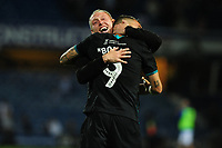 Steve Cooper Head Coach of Swansea City celebrates with Borja Baston of Swansea City at full time during the Sky Bet Championship match between Queens Park Rangers and Swansea City at The Kiyan Prince Foundation Stadium in London, England, UK. Wednesday 21, August 2019