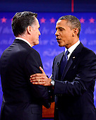 United States President Barack Obama, the Democratic Party nominee for President, and former Massachusetts Governor Mitt Romney, the Republican Party nominee for President, shake hands as they begin the first Presidential Debate of the 2012 General Election at the University of Denver in Denver, Colorado on Tuesday, October 2, 2012..Credit: Ron Sachs / CNP.(RESTRICTION: NO New York or New Jersey Newspapers or newspapers within a 75 mile radius of New York City)