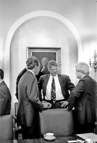 United States President Bill Clinton, center, has a discussion in the Cabinet Room of the White House in Washington, D.C. with United States Senate Minority Leader Bob Dole (Republican of Kansas) and United States House Minority Leader Newt Gingrich (Republican of Georgia) on Wednesday, June 30, 1993..Credit: White House via CNP