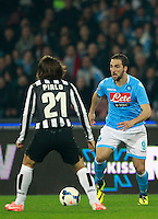 Calcio, Serie A: Napoli vs Juventus. Napoli, stadio San Paolo, 30 marzo 2014. <br /> Napoli forward Gonzalo Higuain, of Argentina, is challenged by Juventus midfielder Andrea Pirlo, left, during the Italian Serie A football match between Napoli and Juventus at Naples' San Paolo stadium, 30 March 2014.<br /> UPDATE IMAGES PRESS/Isabella Bonotto