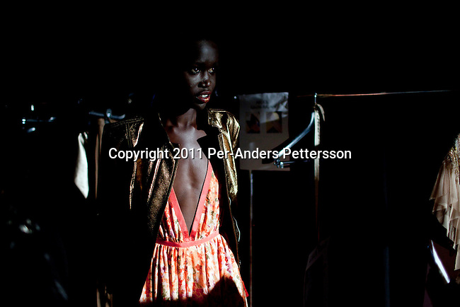CAPE TOWN, SOUTH AFRICA - JULY 14: Sudanese model Akuol de Mabior prepare backstage before a show with the Cape Town based designer Gavin Rajah a fashion show at the the Cape Town Fashion Week on July 14, 2011, in Cape Town, South Africa. Some of South Africa's finest designers showed their 2011 Spring and summer collections during the 3 day event. Photo by Per-Anders Pettersson