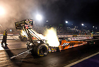 Apr 25, 2014; Baytown, TX, USA; NHRA top fuel driver J.R. Todd in the Jesse James Firearms Unlimited sponsored dragster during qualifying for the Spring Nationals at Royal Purple Raceway. Mandatory Credit: Mark J. Rebilas-USA TODAY Sports