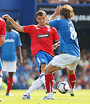 Lee McCulloch goes in hard on Niko Kranjcar