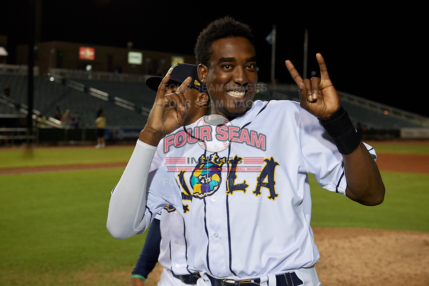 New Orleans Baby Cakes Gabriel Guerrero (27) jokes for the camera after a Pacific Coast League game against the Oklahoma City Dodgers on May 6, 2019 at Shrine on Airline in New Orleans, Louisiana.  New Orleans defeated Oklahoma City 4-0.  (Mike Janes/Four Seam Images)