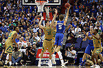10 March 2016: Duke's Luke Kennard (5) shoots over Notre Dame's Steve Vasturia (32) and Zach Auguste (30). The University of Notre Dame Fighting Irish played the Duke University Blue Devils at the Verizon Center in Washington, DC in the Atlantic Coast Conference Men's Basketball Tournament quarterfinal and a 2015-16 NCAA Division I Men's Basketball game. Notre Dame won the game 84-79 in overtime.