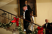 United States President Donald J. Trump, First Lady Melania Trump, and US Vice President Mike Pence ascend the Grand Staircase in front of the portrait of US President Harry S. Truman after greeting guests at the Congressional Ball at White House in Washington on December 15, 2018. <br /> Credit: Yuri Gripas / Pool via CNP