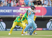 Eoin Morgan (England) drives through the covers for four runs  during Australia vs England, ICC World Cup Semi-Final Cricket at Edgbaston Stadium on 11th July 2019