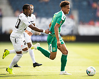 KANSAS CITY, KS - JUNE 26: Elliot Bonds #4 is chased by Jomal Williams #20 during a game between Guyana and Trinidad