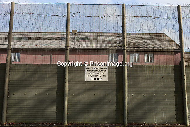 The external wall at Guys Marsh prison has anti drug signs around the perimeter discouraging people from throwing drugs over into the prison. HMP & YOI Guys Marsh, Shaftesbury, Dorset, United Kingdom. Guys Marsh is a category C prison in Dorset and can house 578 prisoners.