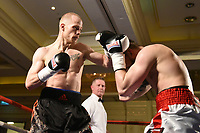 Konrad Stempkowski (black shorts) defeats Lukasz Kuc during a Boxing Show at the Millenium Hotel on 11th May 2017