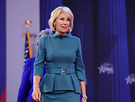 National Harbor, MD - February 22, 2018: U.S. Secretary of Education Betsy Devos enters the Potomac Ballroom to participate in a discussion during the Conservative Political Action Conference (CPAC) at the Gaylord National Hotel in National Harbor, MD, February 22, 2018  (Photo by Don Baxter/Media Images International)