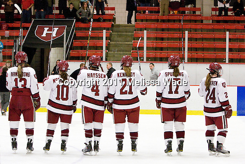 Kalley Armstrong (Harvard - 13), Gina McDonald (Harvard - 10), Hilary Hayssen (Harvard - 4), Whitney Kennedy (Harvard - 21), Kaitlin Spurling (Harvard - 17) and Leanna Coskren (Harvard - 24) salute their fans. - The Harvard University Crimson defeated the St. Lawrence University Saints 8-3 (EN) to win their ECAC Quarterfinals on Saturday, February 26, 2011, at Bright Hockey Center in Cambridge, Massachusetts.