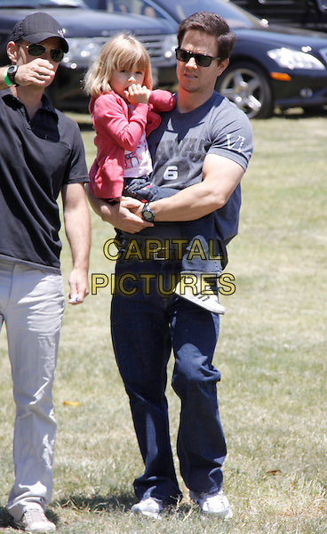 "ELLA RAE & MARK WAHLBERG.The 20th annual ""A Time for Heroes"" Celebrity Carnival benefiting Elizabeth Glaser Pediatric AIDS Foundation held at Wadsworth Theater on the Veteran Administration Lawn in West Los Angeles, California, USA. .June 7th, 2009.full length jeans denim grey gray t-shirt carrying lifting daughter dad father family pink jacket sunglasses shades.CAP/DVS                                                  .©Debbie VanStory/Capital Pictures."