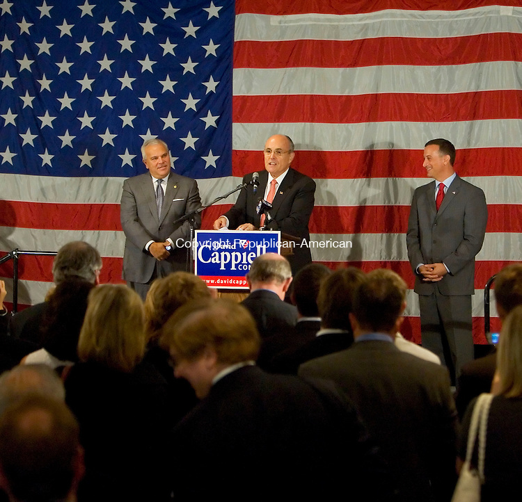 WATERBURY, CT- 01 OCTOBER 2008 --100108JS04--Former New York City Mayor Rudy Giuliani, center, speaks to the crowd as Sen. David Cappiello, R-Danbury, right, a candidate for the Congressional 5th District, and Lt. Gov. Michael Fedele during a fund raiser for Cappiello Wednesday at the Ponte Club in Waterbury. Cappiello is running against Democratic Congressman Chris Murphy.<br /> Jim Shannon / Republican-American