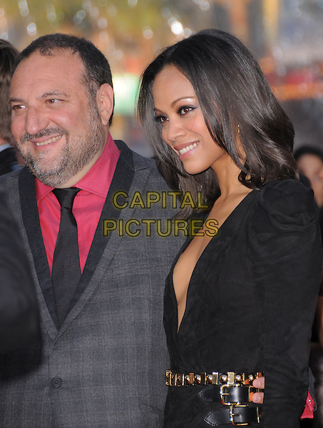 "JOEL SILVER & ZOE SALDANA .at the Warner Bros. Pictures L.A. Premiere of ""The Losers"" held at The Grauman's Chinese Theatre in Hollywood, California, USA,.April 20th 2010..half length grey gray plaid checked check red shirt jacket tie dress  black low cut plunging neckline wrap smiling gold waist belt buckles beard facial hair .CAP/RKE/DVS.©DVS/RockinExposures/Capital Pictures."
