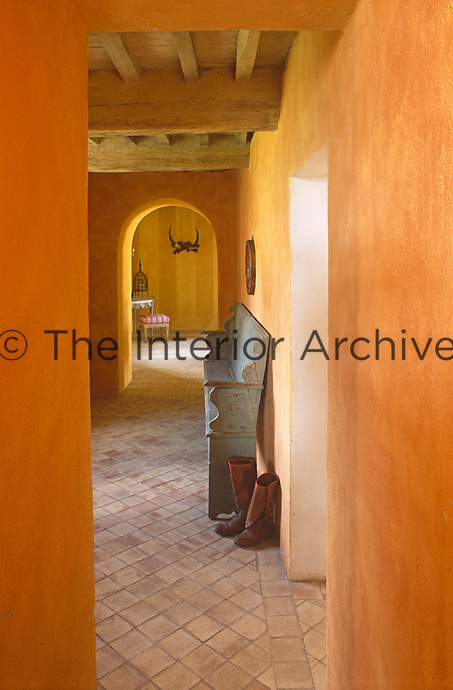 A glimpse through a narrow doorway into the entrance hall