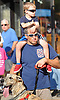 Northport native and FDNY member James McKechnie watches the community's annual Cow Harbor 10-kilometer run with son, Jack, 4, and great dane &quot;Moose&quot; on Saturday, September 19, 2015.<br /> <br /> James Escher