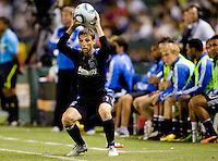 San Jose Earthquakes midfielder Bobby Convey (11) with a squatting throw in. The LA Galaxy and the San Jose Earthquakes played to a 2-2 draw at Home Depot Center stadium in Carson, California on Thursday July 22, 2010.