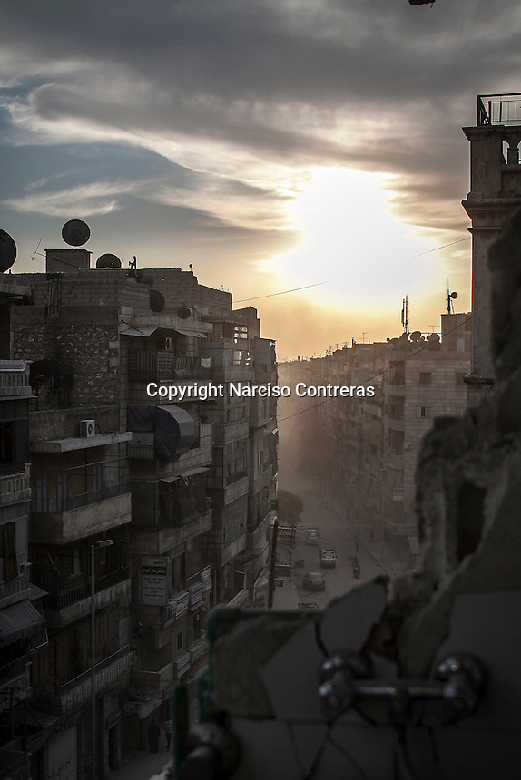 A view over Tarik Al-Bab neighborhood from the fifth floor of one room shattered of a building hit by shelling at the northeeast of Aleppo City.