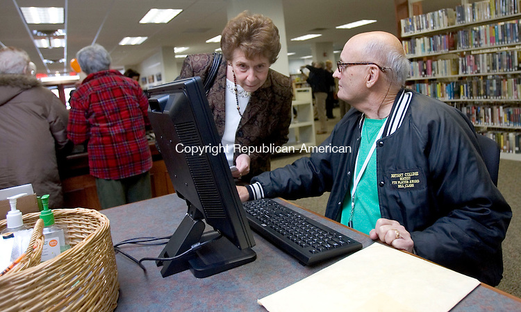 MIDDLEBURY CT. 04 November 2013-110413SV11-From left, Joann Cappelletti, director of social services for Middlebury, and Shep Clark of Middlebury check out the computers for public use at the public library in Middlebury Monday. The library had it grand reopening after a long renovation. <br /> Steven Valenti Republican-American