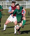 Whitehill's Ryan McKenzie and Stirling's Matt Sheridan challenge for the ball.