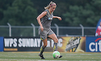 Philadelphia defender, Allison Falk (3), passes the ball to the left midfield.  The Philadelphia Independence scored three first half goals, and went on to win 4-1 over Sky Blue at John A Farrell Stadium in West Chester, Pennsylvania.