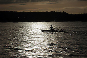 While anchored in a cove on Mary Loring one early evening I saw a man rowing silently across the water with a full moon shining on the water.