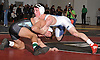 Thomas Dutton of Rocky Point, top, battles Hunter Hulse of Westhampton at 145 pounds during the Suffolk County varsity wrestling Division I semifinals at Hofstra University on Sunday, February 15, 2015. Dutton won the match by decision.<br /> <br /> James Escher