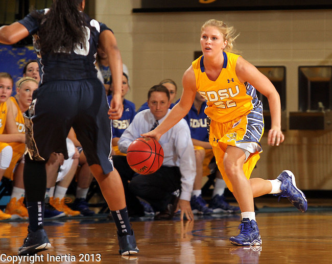 BROOKINGS, SD - NOVEMBER 15:  Chloe Cornemann #22 from South Dakota State University pushes the ball against the defense of Samisha Powell #23 from Georgetown in the first half of their game Friday night at Frost Arena. (Photo by Dave Eggen/Inertia)