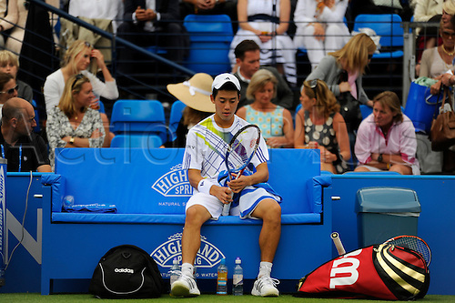 LONDON, UNITED KINGDOM, JUNE 7 2010:Kei Nishikori (JPN) pictured during a break in play in his 1st round match. Nishikori eventually lost  6-3, 6-3 to Richard Gasquet (FRA) during the 2010 Aegon Championships at The Queens Club, London, United Kingdom.