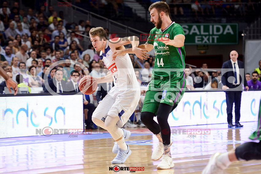 Real Madrid's Luka Doncic and Unicaja Malaga's Dejan Musli during semi finals of playoff Liga Endesa match between Real Madrid and Unicaja Malaga at Wizink Center in Madrid, June 02, 2017. Spain.<br /> (ALTERPHOTOS/BorjaB.Hojas) /NortePhoto.com