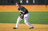 Wake Forest Demon Deacons second baseman Conor Keniry (14) on defense against the Georgetown Hoyas at Wake Forest Baseball Park on February 16, 2014 in Winston-Salem, North Carolina.  The Demon Deacons defeated the Hoyas 3-2.  (Brian Westerholt/Four Seam Images)