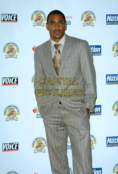 MC HARVEY.The Gift of Life Ball in aid of the Afro Caribbean Leukaemia Trust at the Intercontinental Hotel, Park Lane, London, England..September 22nd 2007.half length 3/4 length grey gray pinstripe suit hands in pockets .CAP/CAN.©Can Nguyen/Capital Pictures
